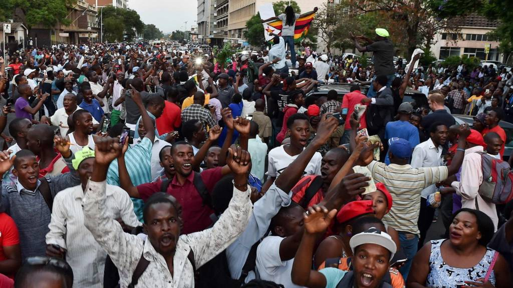 People celebrating in Harare as Mugabe resigns
