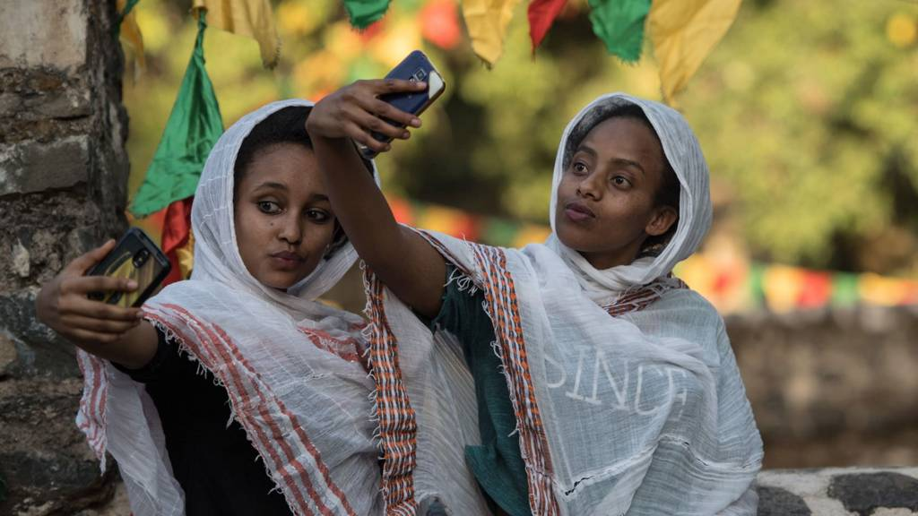 Ethiopian women taking selfies