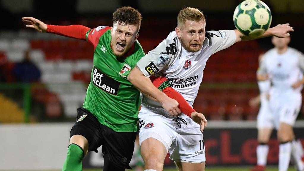 Action from Glentoran against Crusaders