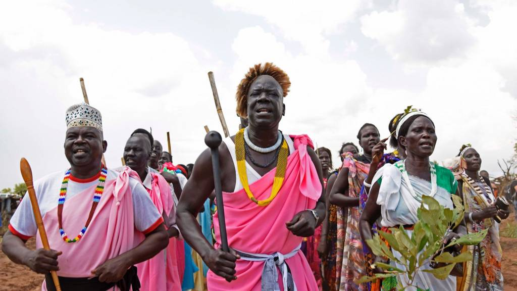 South Sudanese refugees perform a traditional dance as the United Nations High Commissioner for Refugees visits the newly created Pagirinya refugee settlement in Adjumani, north of the capital Kampala on August 29, 2016