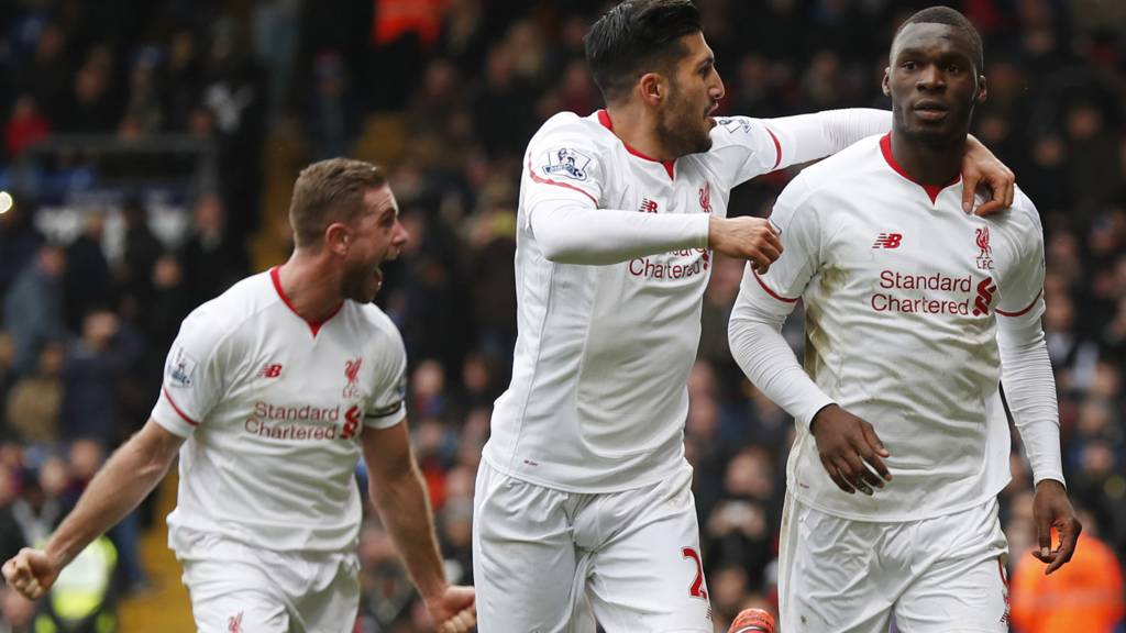 Christian Benteke celebrates his winner for Liverpool with Emre Can