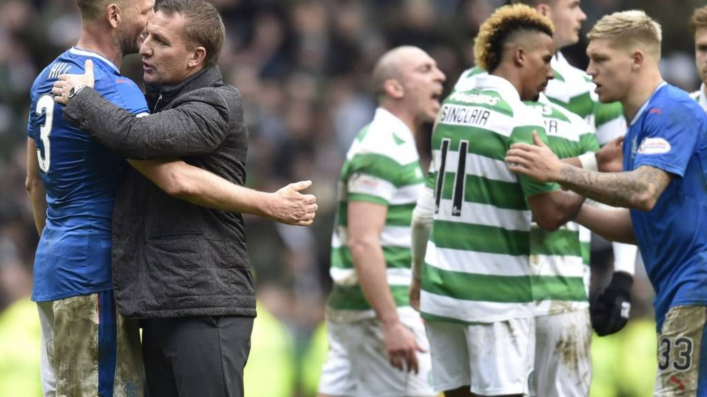 Celtic manager Brendan Rodgers and Rangers defender Clint Hill