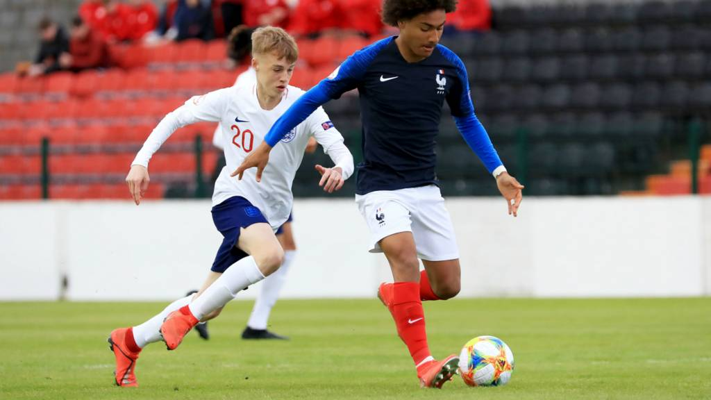 Enzo Millot of France with Cole Palmer of England