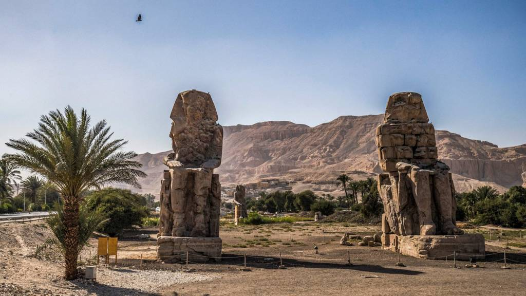 A view of the Colossi of Memnon, two massive stone statues of the 18th dynasty Egyptian pharaoh Amenhote
