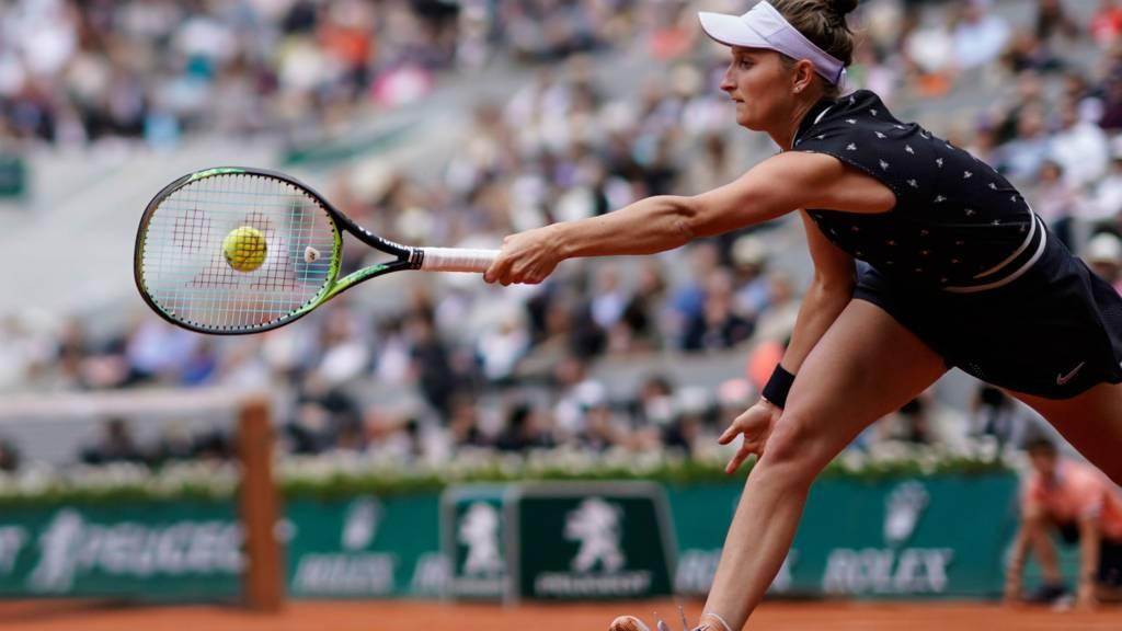 Marketa Vondrousova plays a forehand return