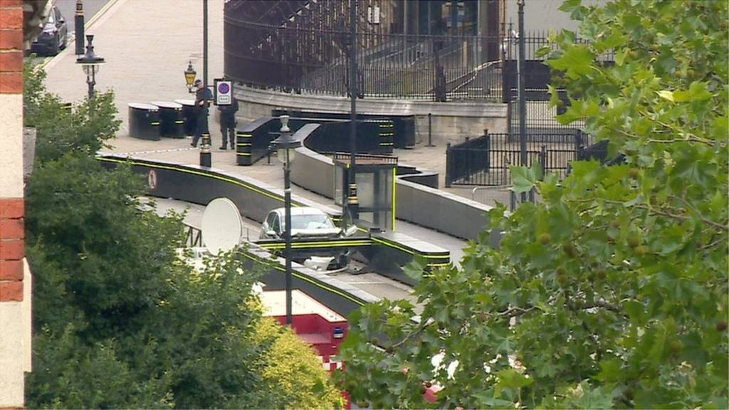 Still frame from BBC News footage of the car which crashed into security barriers outside the Houses of Parliament.
