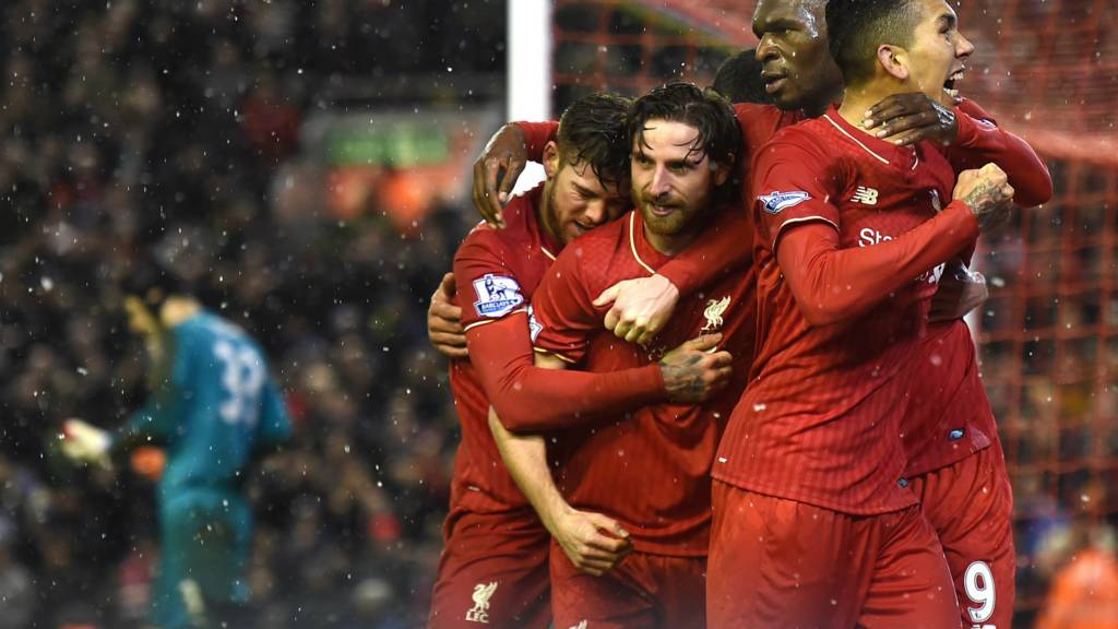 Joe Allen celebrates after scoring for Liverpool
