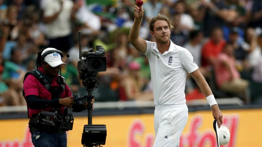 Stuart Broad holds the ball as he leaves the field