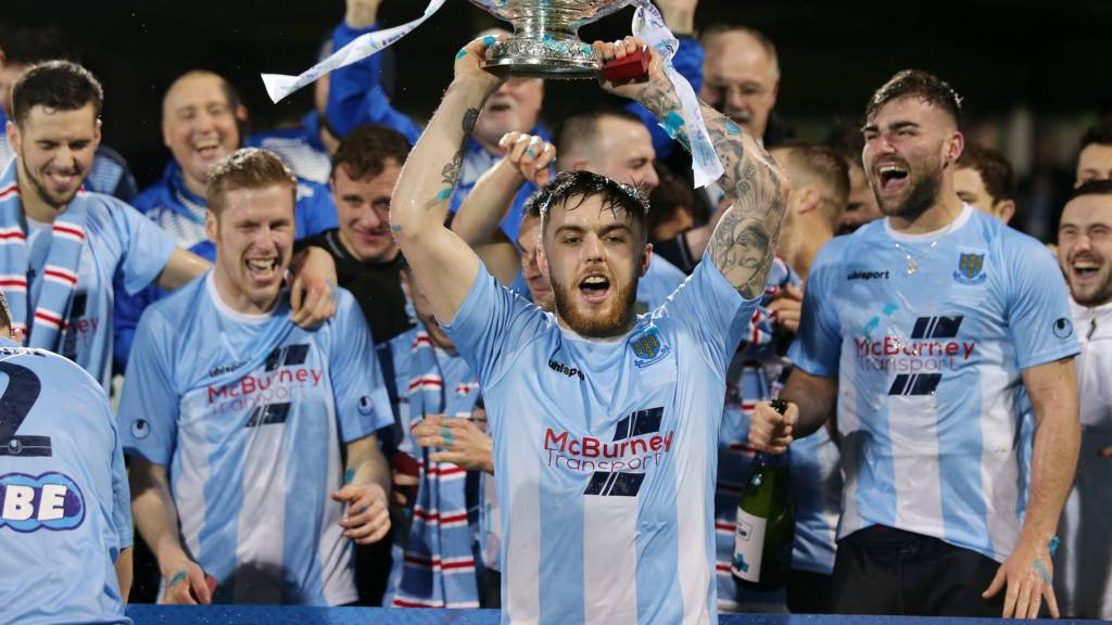 Ballymena United players celebrate with the League Cup