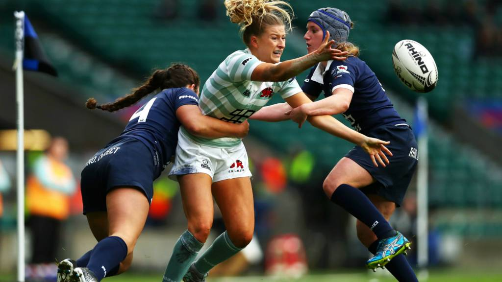 Amelia Miller of Cambridge is tackled