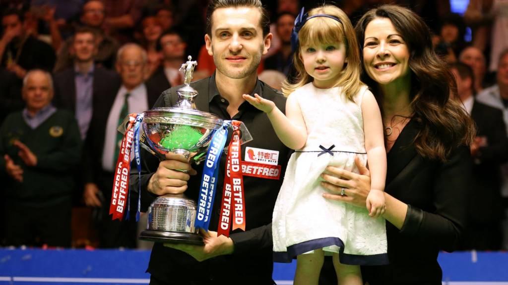 Mark Selby celebrates