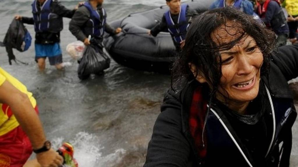 An Afghan migrant arrives on the Greek island of Lesbos in an overcrowded dinghy. Photo: 22 September 2015