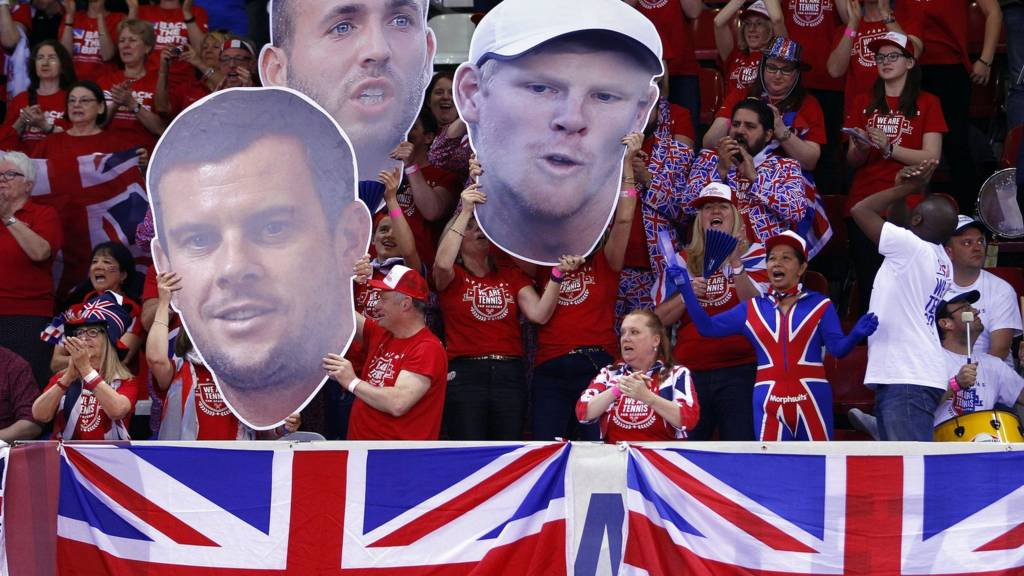 GB fans hold up cut outs of Dan Evans, Kyle Edmund and Leon SMith