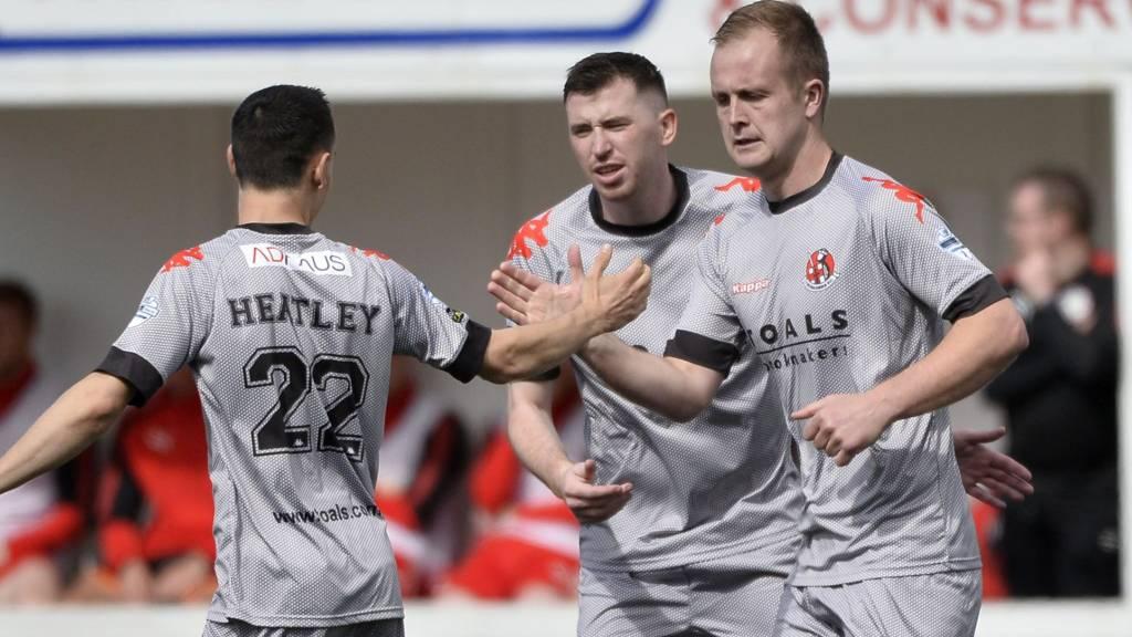 Jordan Owens celebrates with Paul Heatley