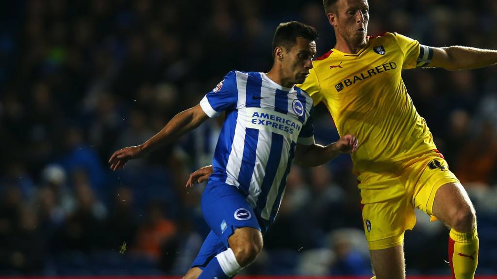 Sam Baldock and Danny Collins battle for the ball