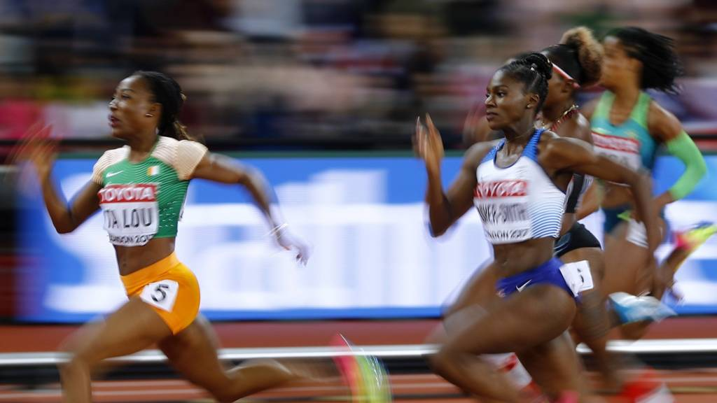 "Women""s 200 Metres Semi-Final - London Stadium, London, Britain – August 10, 2017. Marie-Josee Ta Lou of Ivory Coast wins the heat ahead of Dina Asher-Smith of Great Britain"