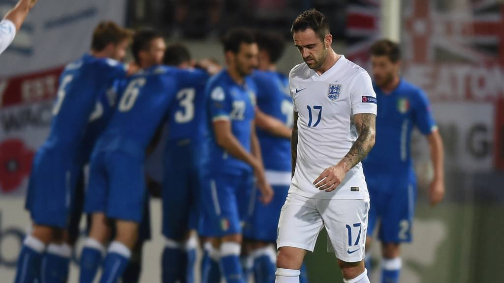 Italy celebrate as Danny Ings looks dejected