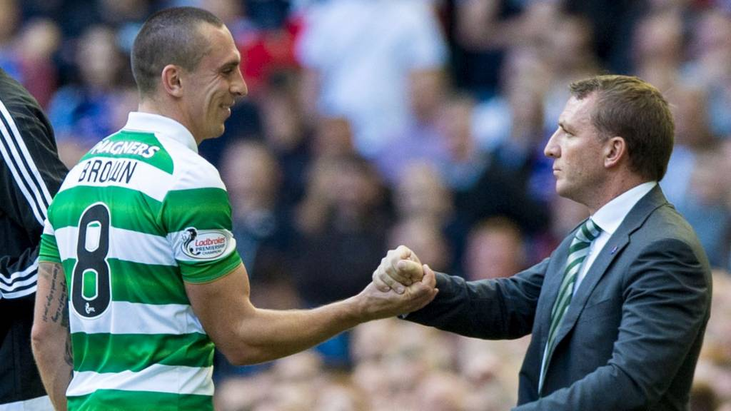 Scott Brown shakes hands with manager Brendan Rodgers as he comes off in Celtic's 5-1 win over Rangers