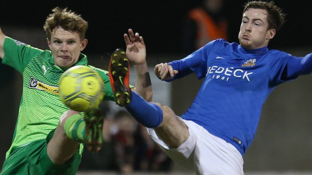 Action from Glenavon against Cliftonville