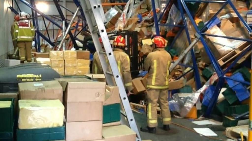collapsed warehouse shelves