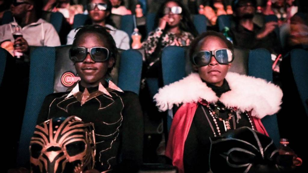 Cosplayers watches the film 'Black Panther' in 3D which featuring Oscar-winning Mexico born Kenyan actress Lupita Nyongo during Movie Jabbers Black Panther Cosplay Screening in Nairobi, Kenya, on February 14, 2018