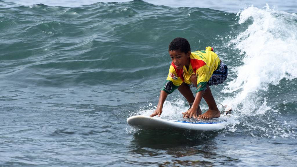 Boy surfing in Senegal