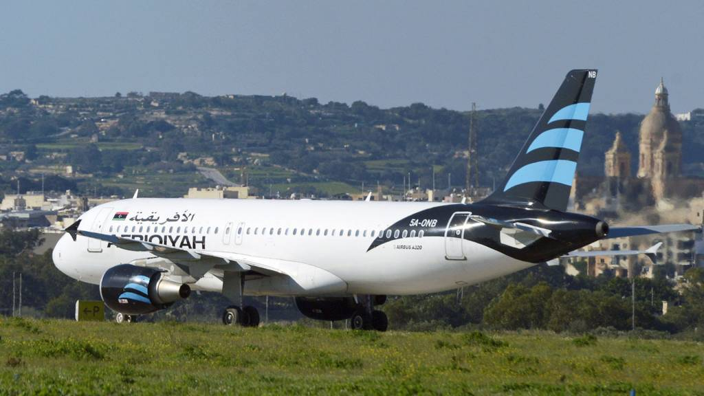 A hijacked Airbus A320 operated by Afriqiyah Airways after it landed at Luqa Airport, in Malta - 23 December 2016