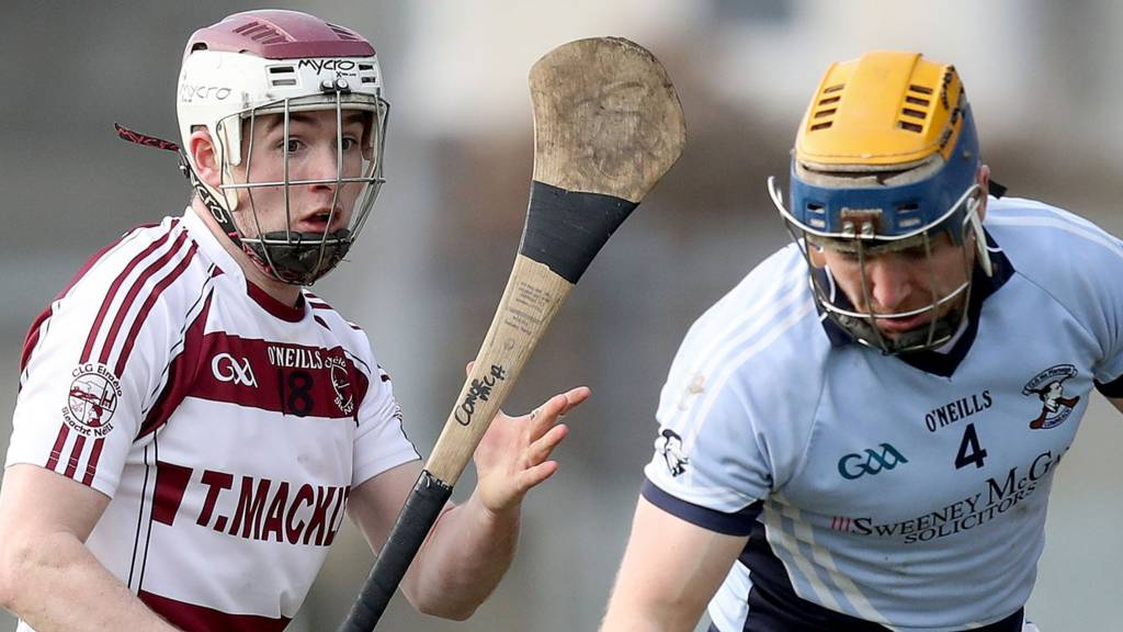 Slaughtneil's Conor McAllister battles with Na Piarsaigh's Niall Buckley