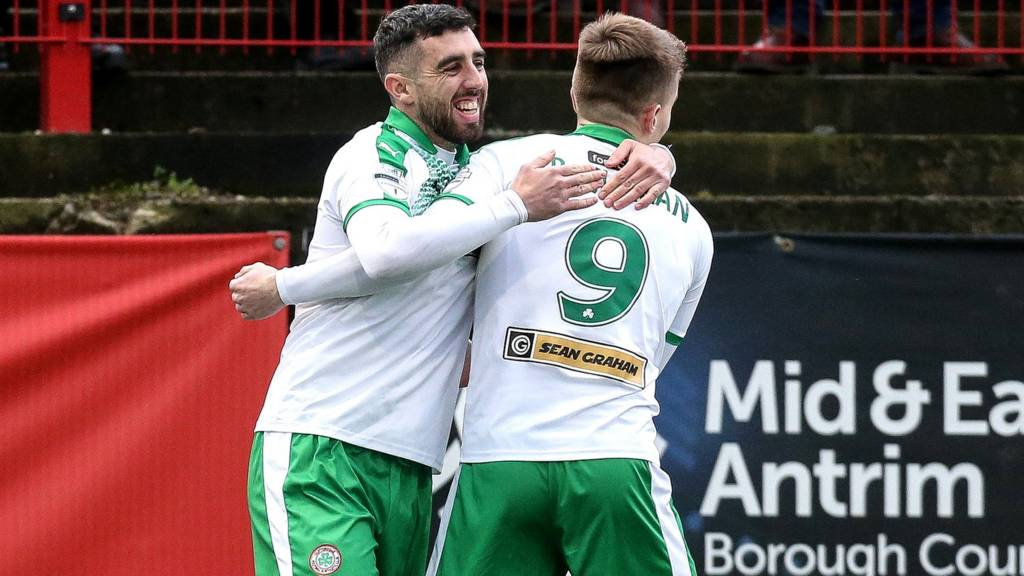 Joe Gormley (left) scored one of Cliftonville's two goals in the 2-1 win at Larne