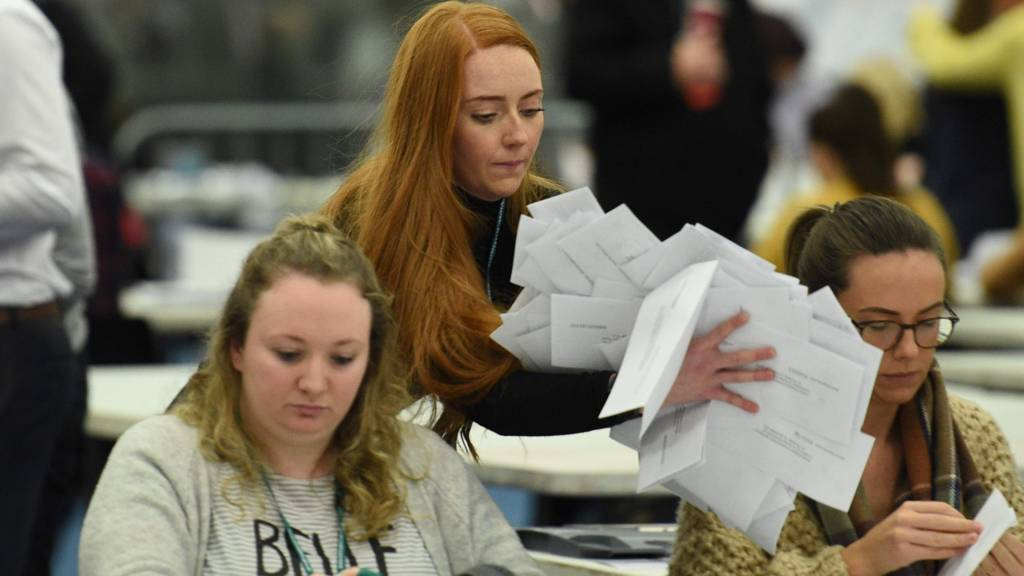 Staff begin counting ballot papers at the count centre in Uxbridge