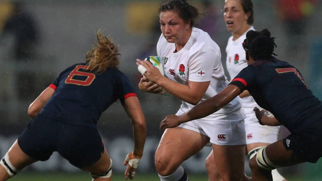 Amy Cokayne of England is tackled