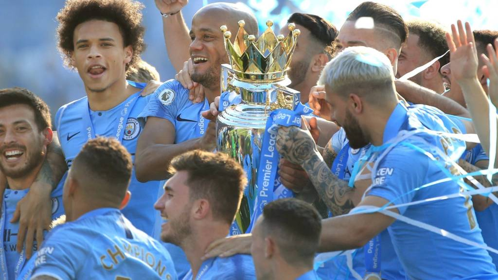 Manchester City lift the Premier League trophy