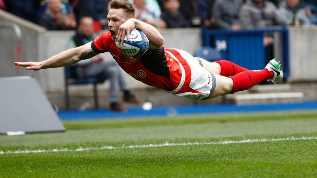 Chris Ashton celebrates scoring a try