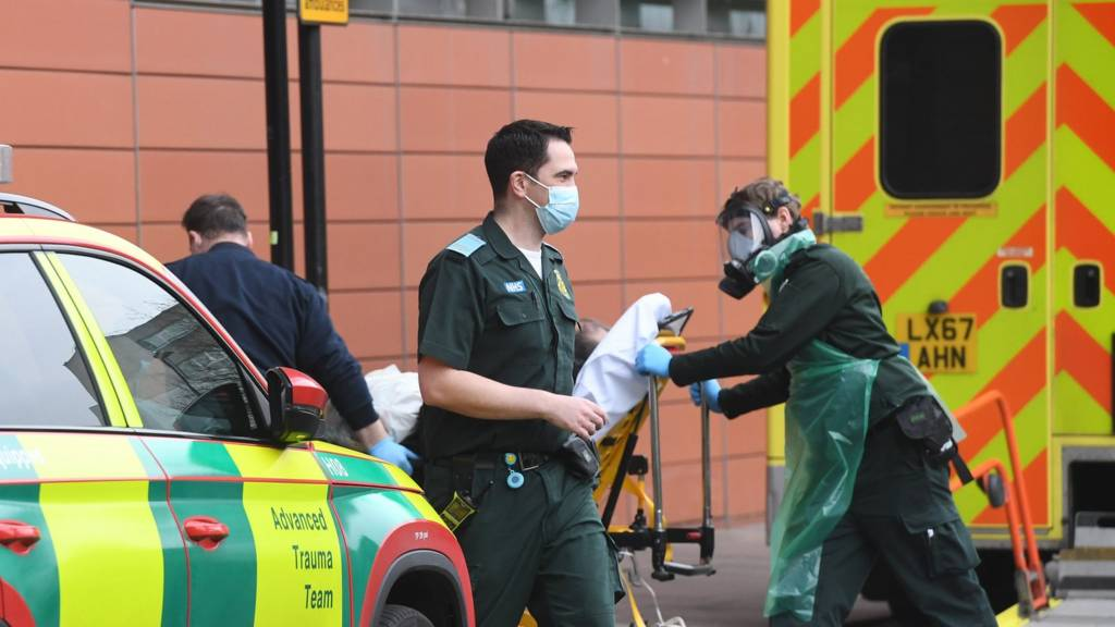 Paramedics with a patient outside a London hospital