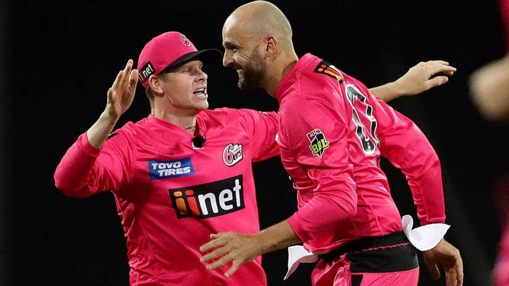 Sydney Sixers players Steve Smith and Nathan Lyon celebrate