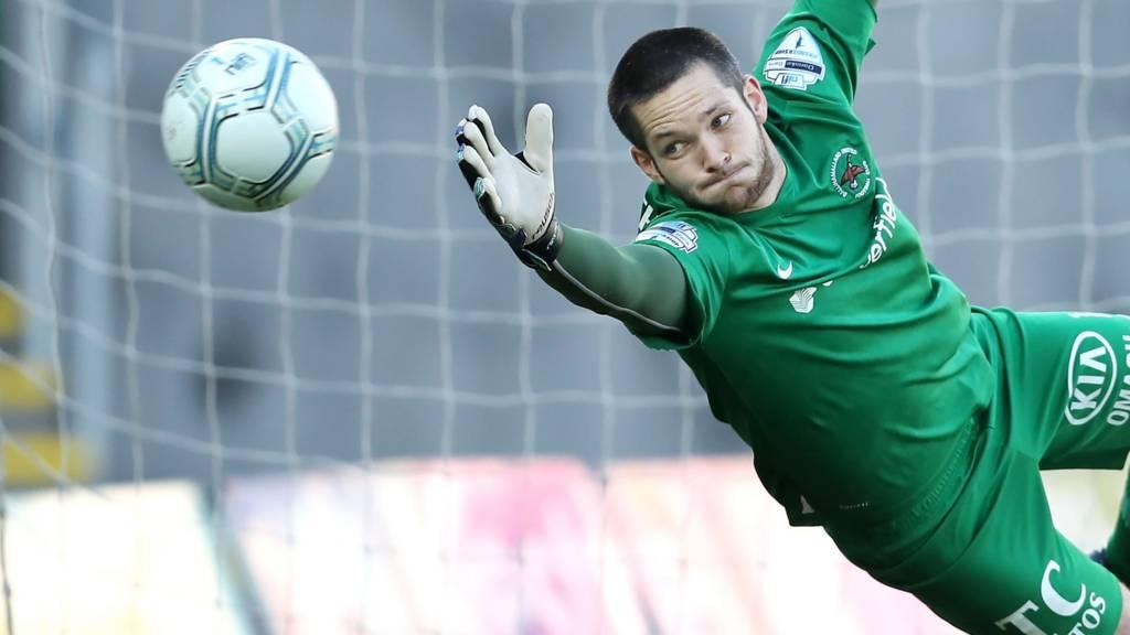 Ballinamallard's James McGrath can't stop Linfield's Sammy Clingan's free-kick