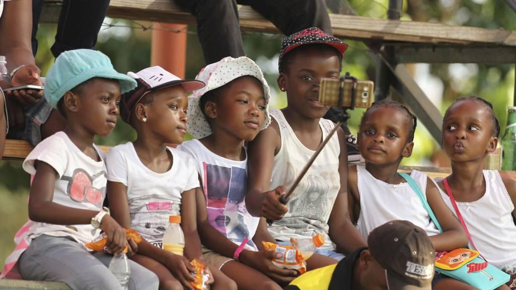 Children taking a selfie in Harare, Zimbabwe