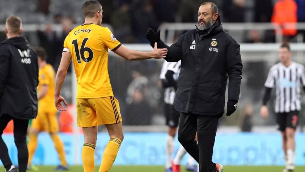 Wolverhampton Wanderers manager Nuno Espirito Santo shakes hands with Conor Coady