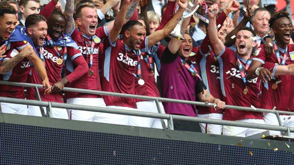 Aston Villa players lift the Championship play-off trophy