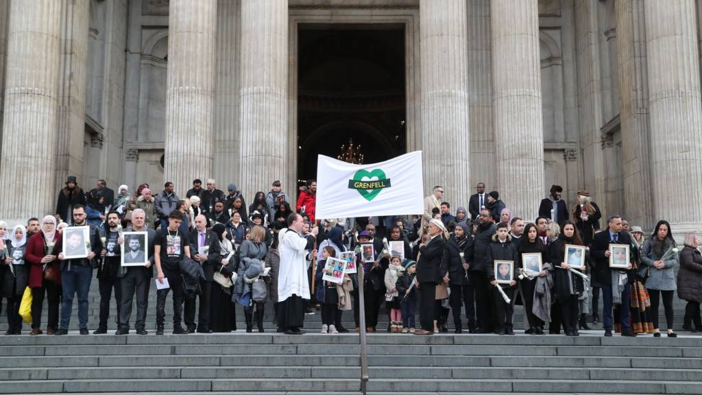 People gather on the steps after the Grenfell Tower memorial service