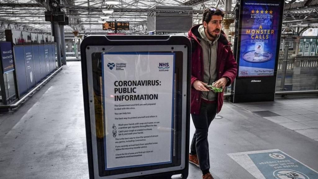 Man walks through deserted Edinburgh Waverely