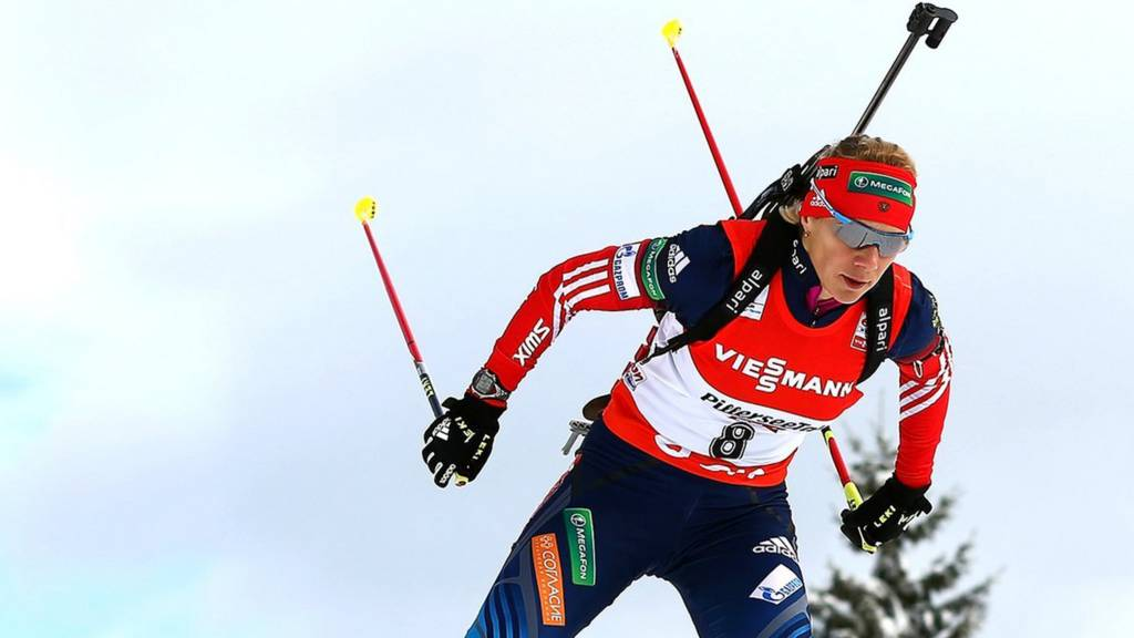 A biathlon competitor in action