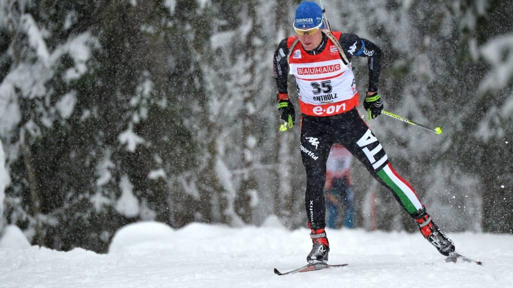 Italy's Lukas Hofer in action in the men's biathlon