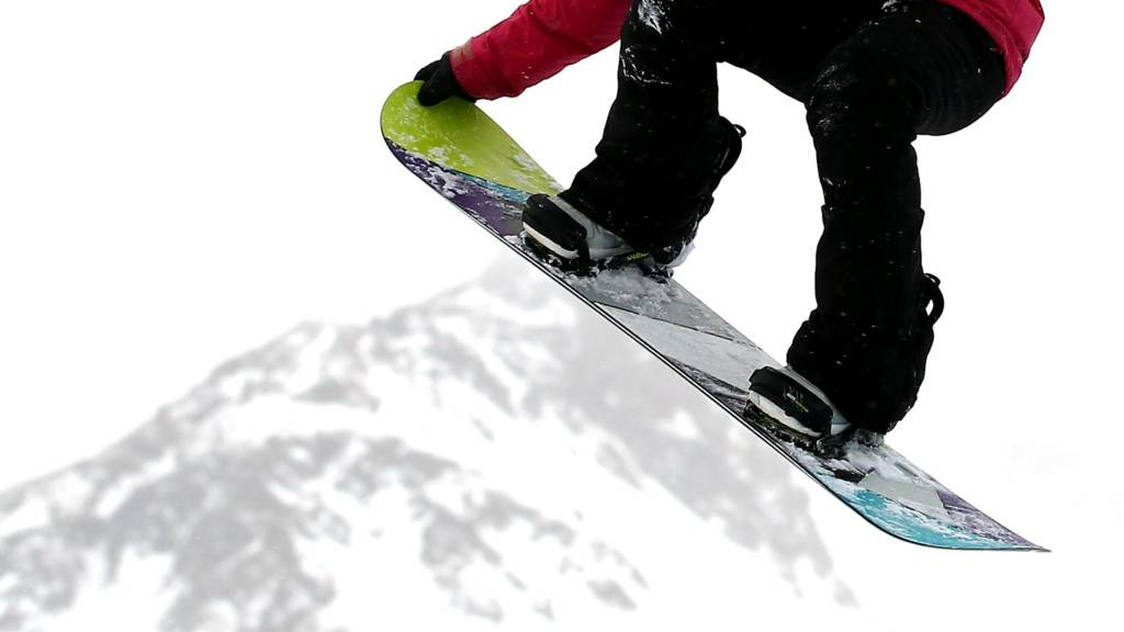 A snowboarder in action