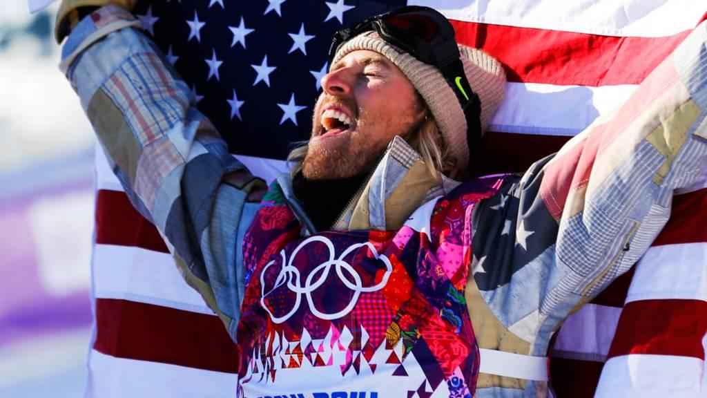 Sage Kotsenburg celebrates winning a gold medal