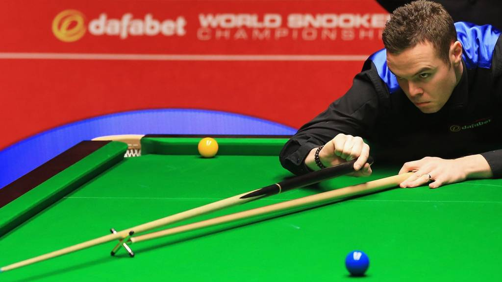 Jamie Cope takes a shot during his first round match against Shaun Murphy