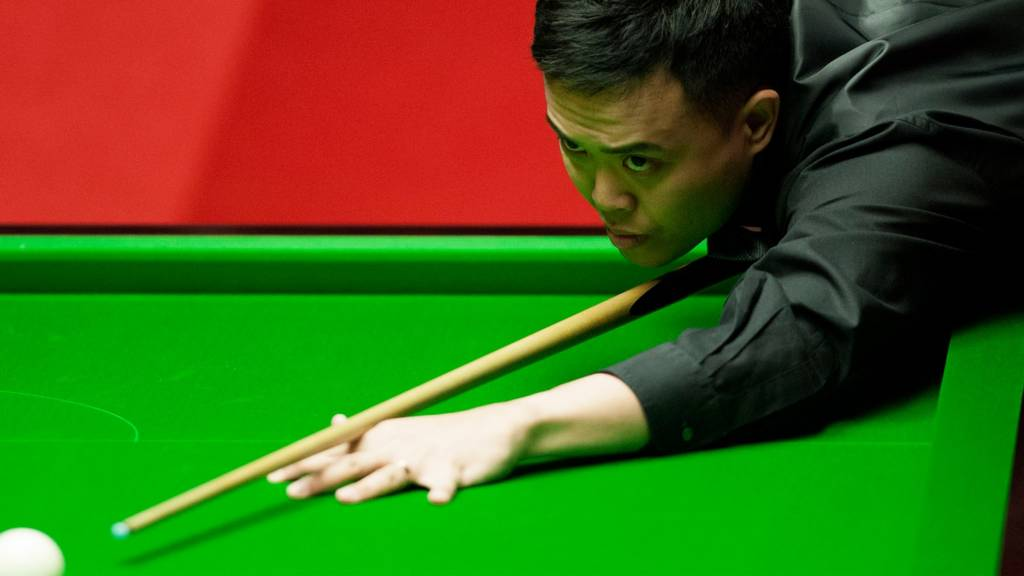 Marco Fu during the first round of the World Snooker Championship 2014