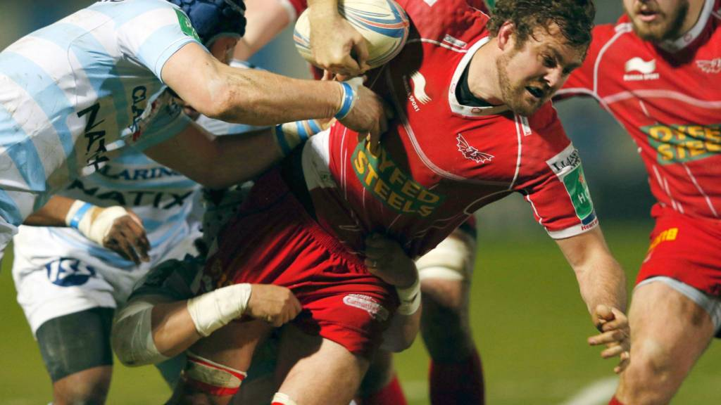 Scarlets star Johan Snyman charges through a tackle against Racing Metro