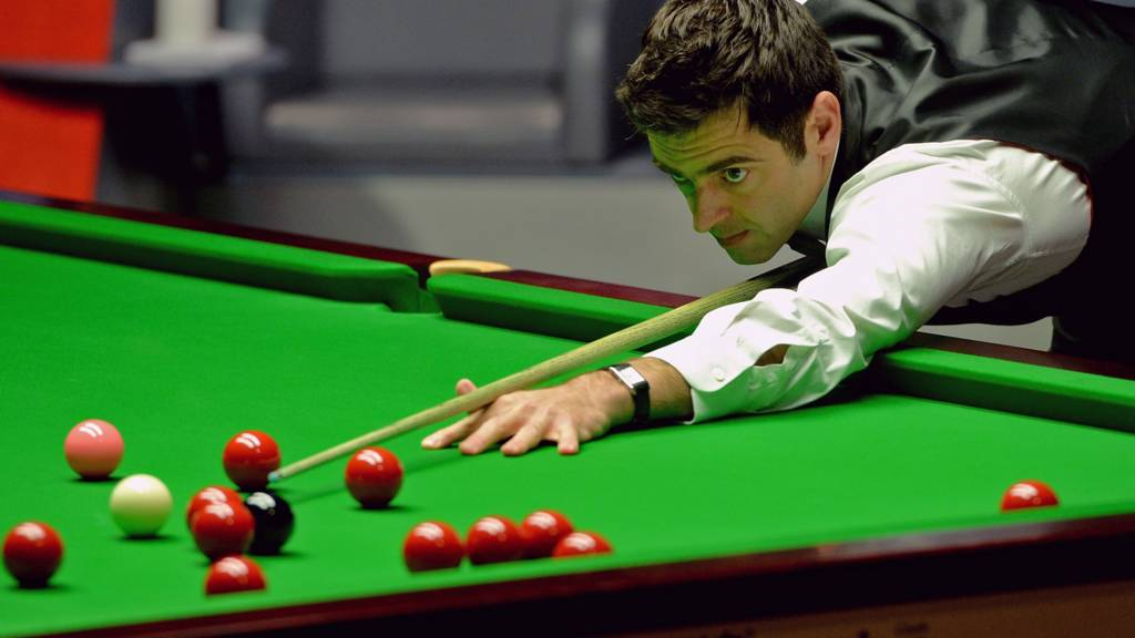 Ronnie O'Sullivan cues carefully at the final of the World Snooker Championship