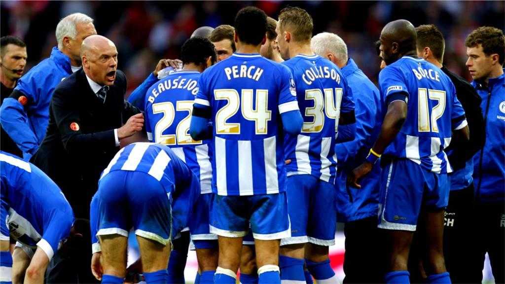 Uwe Rosler gees up his Wigan Athletic side